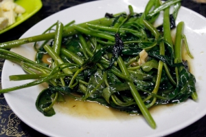 "ผัดพักบุงไฟแดง, or stir-fried morning glory. In Vietnamese, the plant is called ""rau mung."" (Please excuse my lack of diacritics.)"