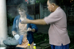 Cooking the morning glory with Maew's instruction.